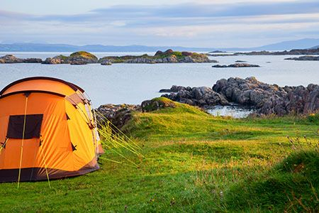 Total-Camping-Ireland-Orange-Tent-looking-out-over-the-sea-small