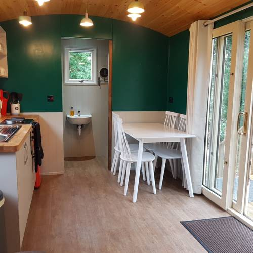 Annascaul Train Carriage kitchen and dining area