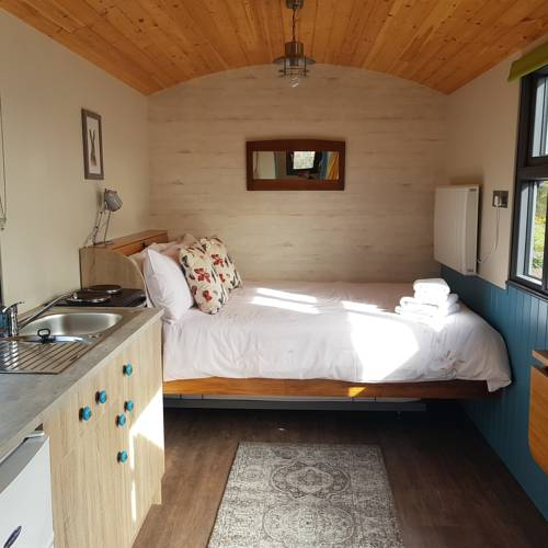 Dingle Way Glamping bed and small kitchenette